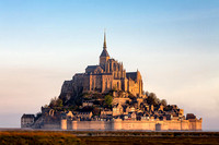 Raising sun at Mont Saint Michel, France